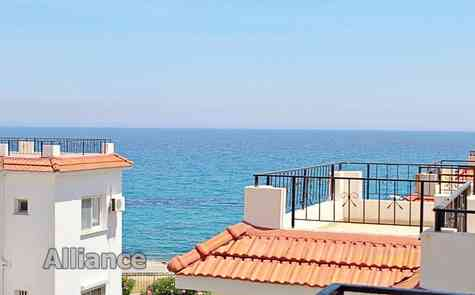 Three bedroom apartment with private roof terrace in Lapta