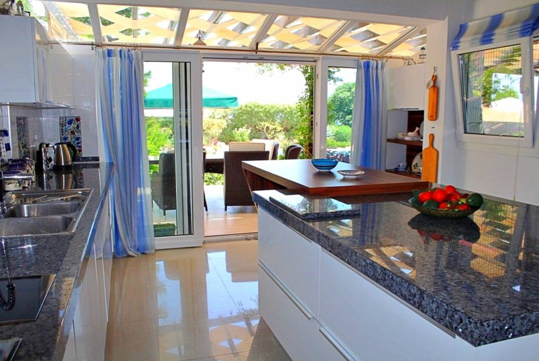 Luxury villa by the sea with large garden and furnishings.