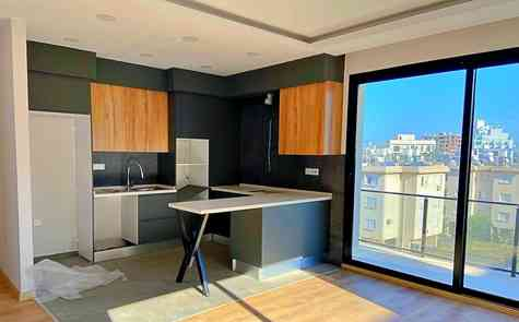 Modern 2 + 1 apartment in a complex in the center of Kyrenia with underground parking