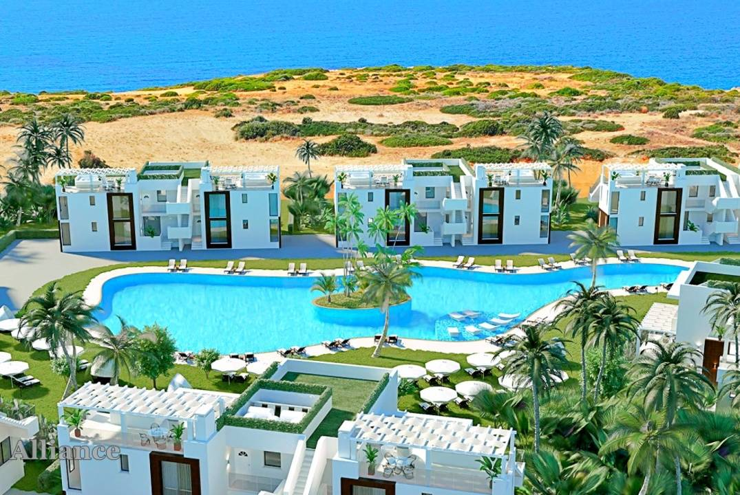 Apartment with garden and penthouse in a complex by the sea with a beach