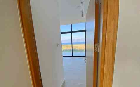 Luxury apartment 2 + 1 with private garden in a complex on the sea