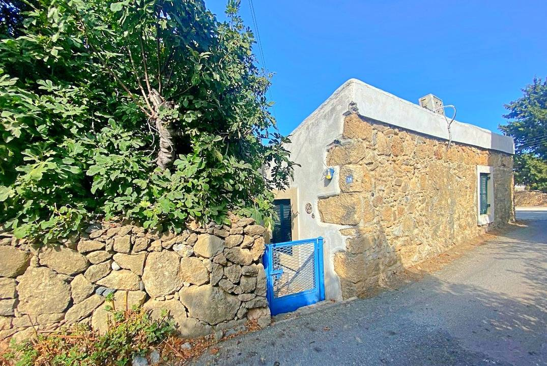 Two traditional Cypriot bungalows on land with Turkish titles